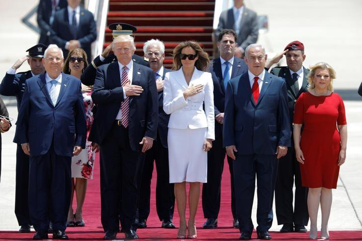 U.S. President Donald Trump (2nd L) and first lady Melania Trump (3rd L) walk with Israeli Prime Minister Benjamin Netanyahu (2nd R), his wife Sara (R) and David Friedman (Center back), the new United States Ambassador to Israel, upon their arrival at Ben Gurion International Airport in Lod near Tel Aviv, Israel May 22, 2017. REUTERS/Amir Cohen