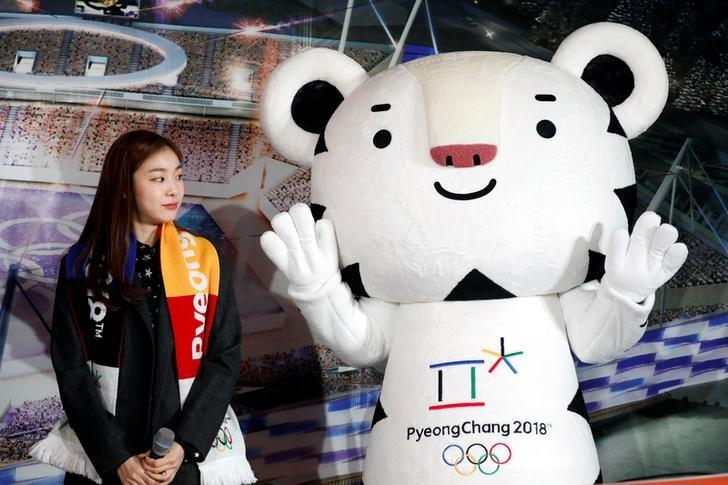 The PyeongChang Organizing Committee for the 2018 Olympic and Paralympic Winter Games (POCOG) Honorary Ambassador Kim Yuna looks at the Olympic mascot ''Soohorang'' during the ceremony to mark a year to the 2018 PyeongChang Winter Olympic Games in Gangneung, South Korea February 9, 2017. REUTERS/Kim Hong-Ji/Files