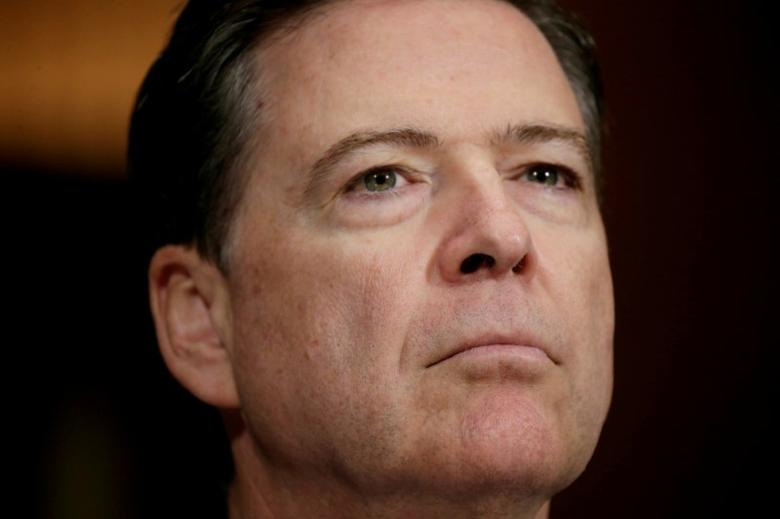 FILE PHOTO: FBI Director James Comey arrives to testify before a Senate Judiciary Committee hearing on ''Oversight of the Federal Bureau of Investigation'' on Capitol Hill in Washington, U.S., May 3, 2017. REUTERS/Kevin Lamarque/File Photo