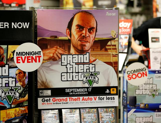 FILE PHOTO: A promotion for the computer game ''Grand Theft Auto Five'' is show in a Game Stop gaming story in Encinitas, California September 17, 2013.     REUTERS/Mike Blake/File Photo