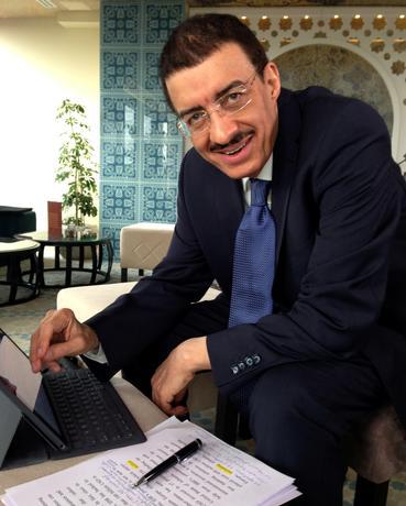 Bandar Hajjar, The Islamic Development Bank President work on his laptop before interview for Reuters in Sarajevo, Bosnia and Herzegovina May 23, 2017. REUTERS/Maja Zuvela