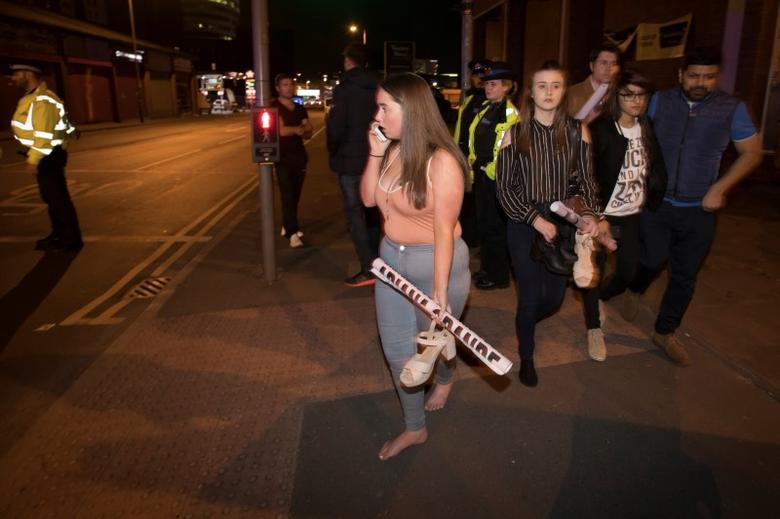 Concert goers react after fleeing the Manchester Arena in northern England where U.S. singer Ariana Grande had been performing in Manchester, Britain, May 22, 2017. REUTERS/Jon Super