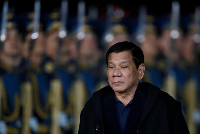Philippine President Rodrigo Duterte inspects the honour guard during a welcoming ceremony upon his arrival at Vnukovo International Airport in Moscow, Russia, May 22, 2017. REUTERS/Maxim Shemetov