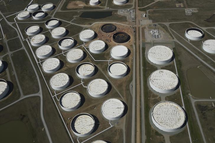 Crude oil storage tanks are seen from above at the Cushing oil hub, in Cushing, Oklahoma, March 24, 2016. REUTERS/Nick Oxford