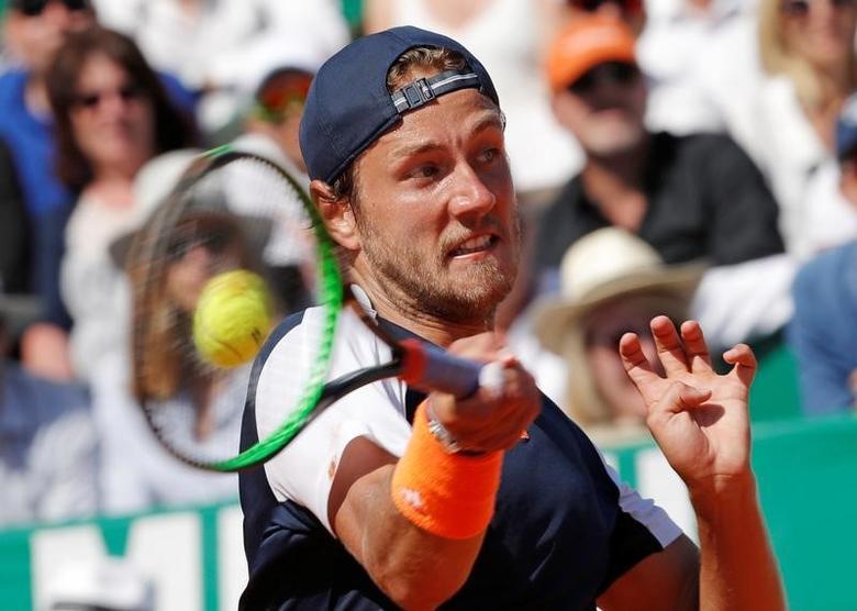 Tennis - Monte Carlo Masters - Monaco, 22/04/2017. Lucas Pouille of France plays a shot to Albert Ramos-Vinolas of Spain .      REUTERS/Eric Gaillard