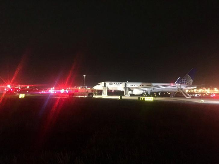 United Airlines Flight 1579 sits on the tarmac at Newark Liberty International Airport after flames were reported coming from an engine, according to the Federal Aviation Administration,  in Newark, New Jersey, U.S.,  May 23, 2017.    Courtesy Oliver Roup/Twitter/Handout via REUTERS