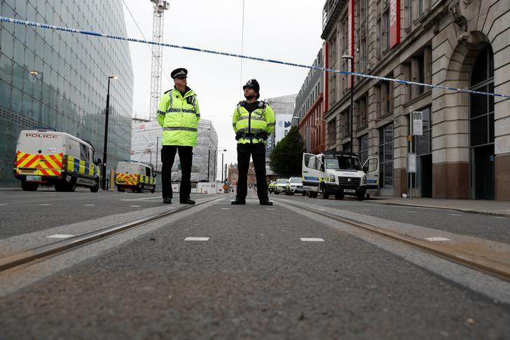 Police stand in the vicinity of Manchester arena in Manchester, Britain May 24, 2017. REUTERS/Peter Nicholls