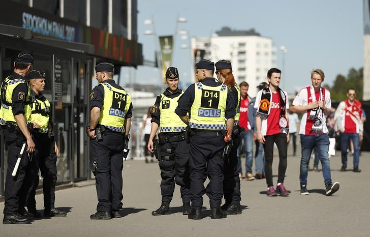 Britain Football Soccer - Ajax Amsterdam v Manchester United - UEFA Europa League Final - Friends Arena, Solna, Stockholm, Sweden - 24/5/17 Police officers and Ajax fans outside the stadium before the match Reuters / Lee Smith Livepic