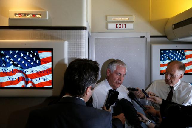 U.S. Secretary of State Rex Tillerson speaks to reporters en route with President Donald Trump to a NATO summit in Brussels aboard Air Force One May 24, 2017.  REUTERS/Jonathan Ernst
