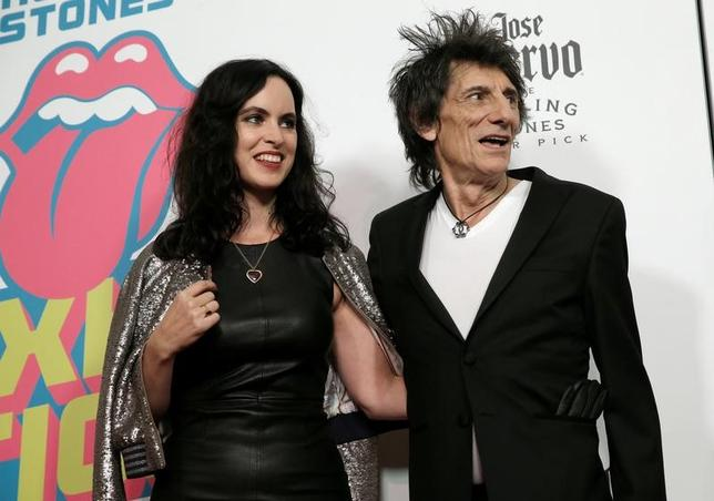 Rolling Stones member Ronnie Wood and his wife Sally Humphreys pose for photographers at the opening of the new exhibit ''Exhibitionism: The Rolling Stones'' in the Manhattan borough of New York City, U.S., November 15, 2016.  REUTERS/Mike Segar