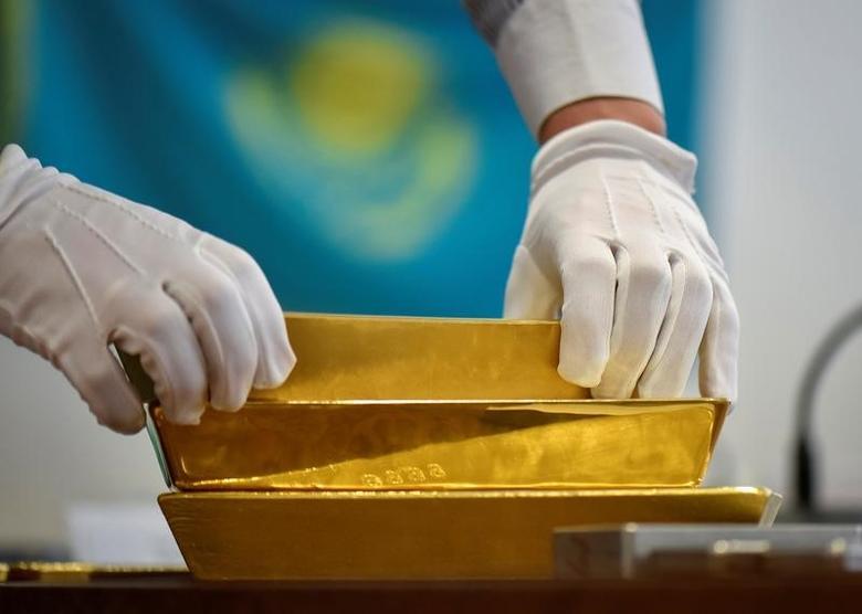 An employee places gold bars in the Kazakhstan's National Bank vault in Almaty, Kazakhstan, September 30, 2016.  REUTERS/Mariya Gordeyeva -