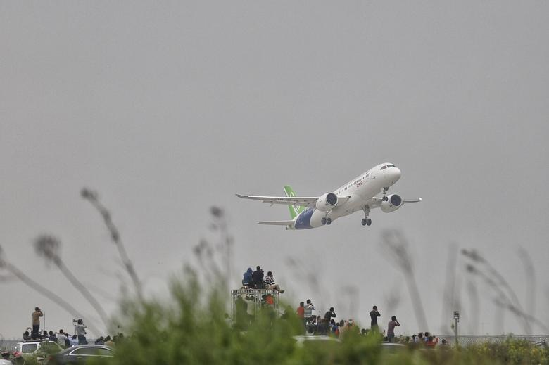 China's home-grown C919 passenger jet takes off on its first flight at Pudong International Airport in Shanghai, Friday, May 5, 2017. REUTERS/Stringer