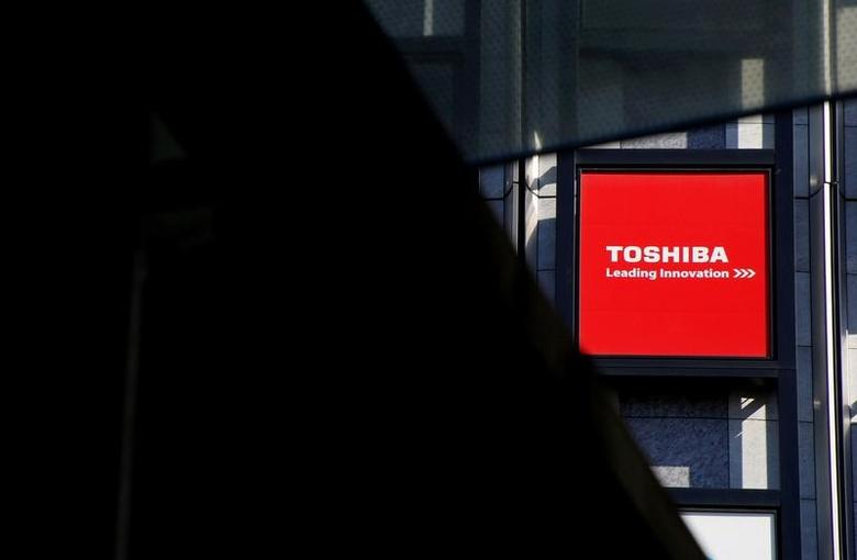 A logo of Toshiba Corp is seen outside an electronics retail store in Tokyo, Japan, February 14, 2017. REUTERS/Toru Hanai/Files