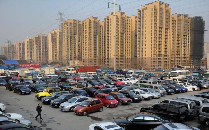 Car dealers and customers walk at a second-hand car market near a newly-built residential area in Hefei, Anhui province, China January 26, 2013.REUTERS/Stringer/Files