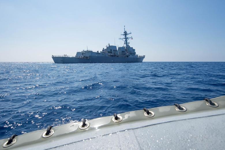 Arleigh Burke-class guided-missile destroyer USS Dewey transits the South China Sea May 6, 2017.  Kryzentia Weiermann/Courtesy U.S. Navy/Handout via REUTERS