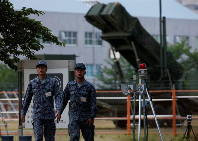 Japan Self-Defense Forces soldiers are seen in front of a unit of Patriot Advanced Capability-3 (PAC-3) missiles at the Defense Ministry in Tokyo, Japan, May 21, 2017. REUTERS/Kim Kyung-Hoon