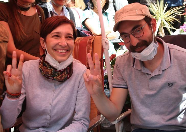 Nuriye Gulmen, a literature professor, and Semih Ozakca, a primary school teacher, who have been on hunger strike after they both lost their jobs in a crackdown following a failed July coup against President Tayyip Erdogan, take part in a protest against a government purge in Ankara, Turkey, May 11, 2017. REUTERS/Stringer