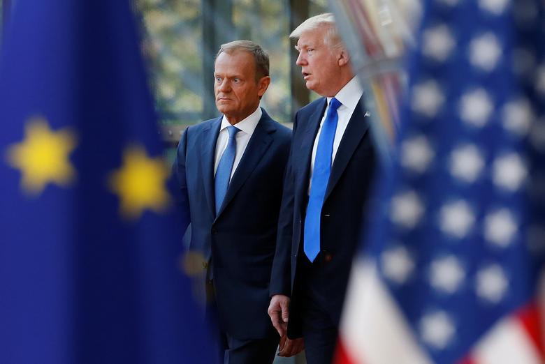 President Trump walks with the President of the European Council Donald Tusk in Brussels, Belgium. REUTERS/Francois Lenoir