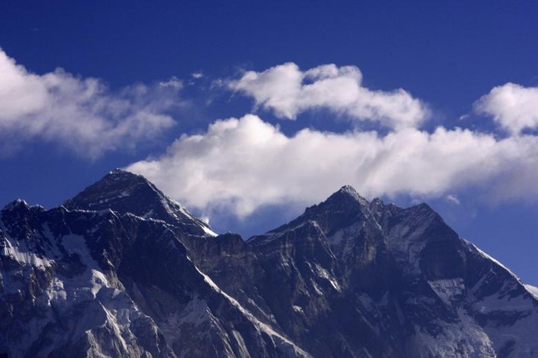 Cloud rise behind Mount Everest, the world's highest peak at 8,848 metres (29,029 ft), as seen from Kongde near Namche Bazar March 5, 2009. REUTERS/Gopal Chitrakar/Files
