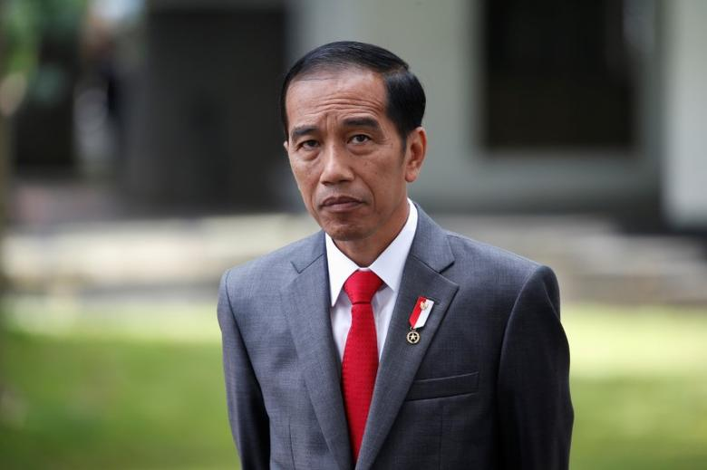 FILE PHOTO: Indonesia President Joko Widodo stands as he waits for the arrival of French President Francois Hollande at the presidential palace in Jakarta, Indonesia March 29, 2017. REUTERS/Beawiharta