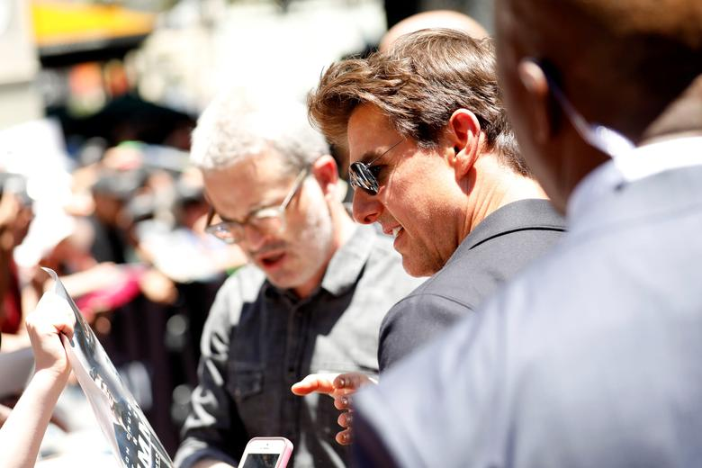 Actor Tom Cruise signs autographs after unveiling a 75-foot tall sarcophagus to promote the film ''The Mummy'' at the Hollywood and Highland gateway in Hollywood, California, May 20, 2017. REUTERS/Patrick T. Fallon
