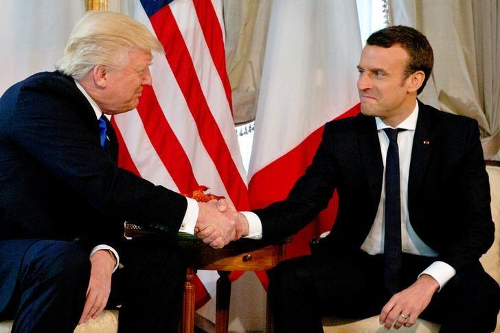 U.S. President Donald Trump (L) shakes hands with French President Emmanuel Macron before a working lunch ahead of a NATO Summit in Brussels, Belgium, May 25, 2017.     REUTERS/Peter Dejong/Pool