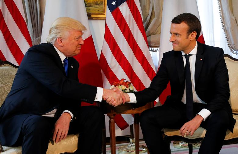 President Trump and French President Emmanuel Macron shake hands. REUTERS/Jonathan Ernst