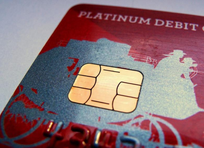FILE PHOTO - A computer chip is seen on newly issued debit/credit card in this photo illustration taken in Encinitas, California September 28, 2015. REUTERS/Mike Blake/File Photo