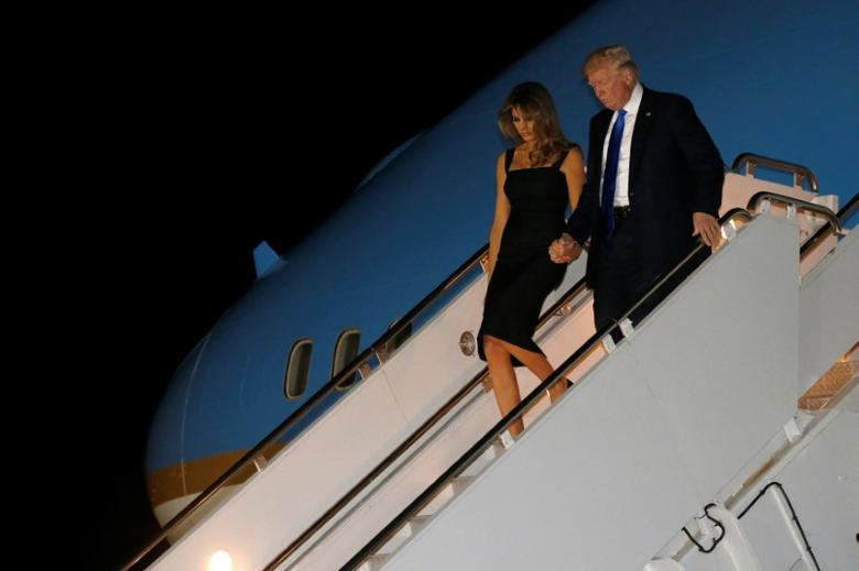 U.S. President Donald Trump and first lady Melania Trump arrive aboard Air Force One at Sigonella Air Force Base at Naval Air Station Sigonella in Sicily, Italy May 25, 2017.  REUTERS/Jonathan Ernst