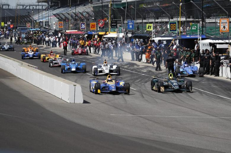 May 22, 2017; Indianapolis, IN, USA; Verizon IndyCar Series driver Alexander Rossi (98) leads a pack of cars out of the pits during practice for the 101st Running of the Indianapolis 500 at Indianapolis Motor Speedway. Mandatory Credit: Brian Spurlock-USA TODAY Sports