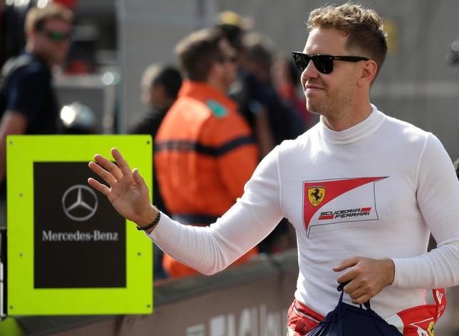 5月25日、自動車レースF1の今季第6戦、モナコ・グランプリ(GP)は、当地でフリー走行2回目を行い、総合首位のセバスチャン・フェテル(ドイツ、フェラーリ)がモナコGP史上最速タイムを更新した(2017年 ロイター/Max Rossi)