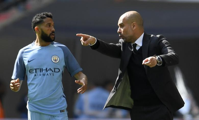 Britain Football Soccer - Arsenal v Manchester City - FA Cup Semi Final - Wembley Stadium - 23/4/17 Manchester City manager Pep Guardiola speaks to Gael Clichy during the game Reuters / Toby Melville Livepic