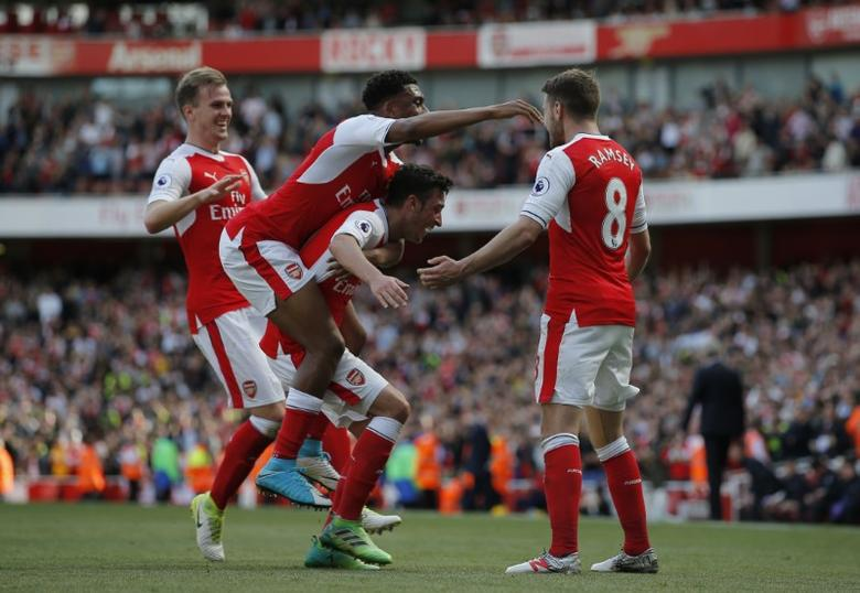 Britain Football Soccer - Arsenal v Everton - Premier League - Emirates Stadium - 21/5/17 Arsenal's Aaron Ramsey celebrates with teammates after scoring their third goal  Action Images via Reuters / Andrew Couldridge Livepic