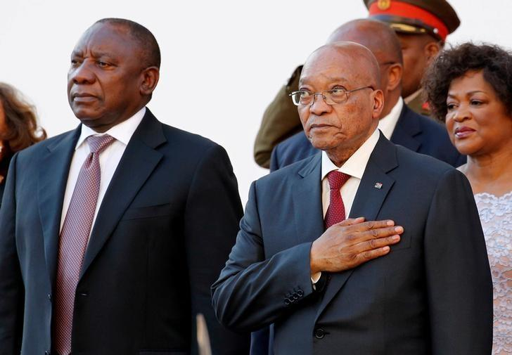 FILE PHOTO: South Africa's Deputy President Cyril Ramaphosa (L) and President Jacob Zuma listen to the national anthem at the opening of Parliament in Cape Town, South Africa February 11, 2016. REUTERS/Mike Hutchings/File Photo