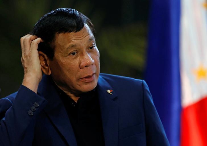 Philippine President Rodrigo Duterte speaks during a news conference at the Ninoy Aquino International Airport in Paranaque, Metro Manila, Philippines May 24, 2017. REUTERS/Erik De Castro