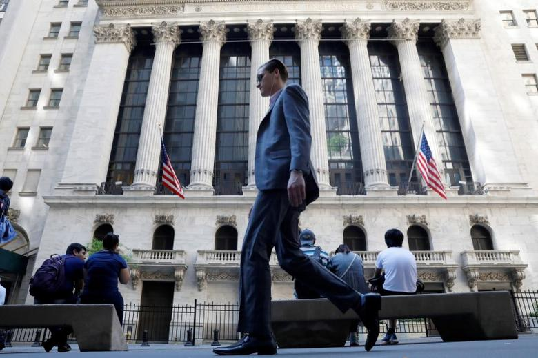 A man walks past the New York Stock Exchange in New York City, U.S., May 17, 2017. REUTERS/Brendan McDermid