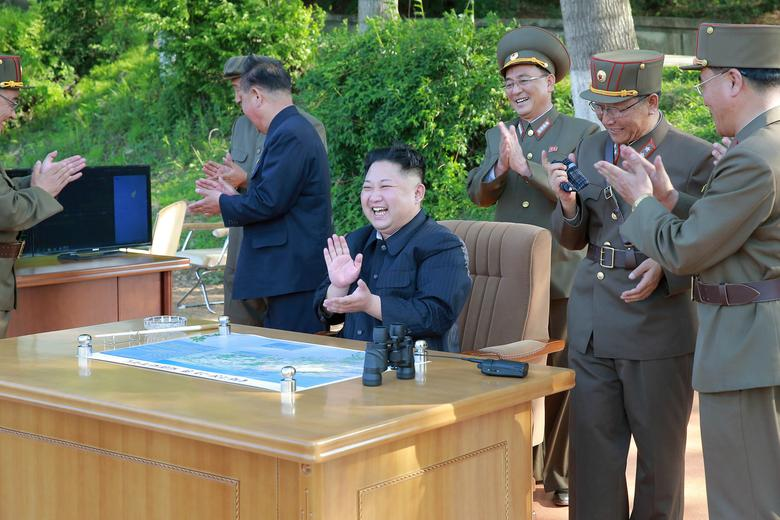 FILE PHOTO : North Korean leader Kim Jong Un inspects the intermediate-range ballistic missile Pukguksong-2's launch test with Ri Pyong Chol (2nd L in black uniform) and Jang Chang Ha (R) in this undated photo released by North Korea's Korean Central News Agency (KCNA) May 22, 2017. REUTERS/KCNA/File Photo