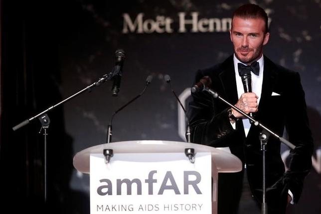 70th Cannes Film Festival - The amfAR's Cinema Against AIDS 2017 event - Auction - Antibes, France. 25/05/2017. David Beckham talks during auction. REUTERS/Stephane Mahe
