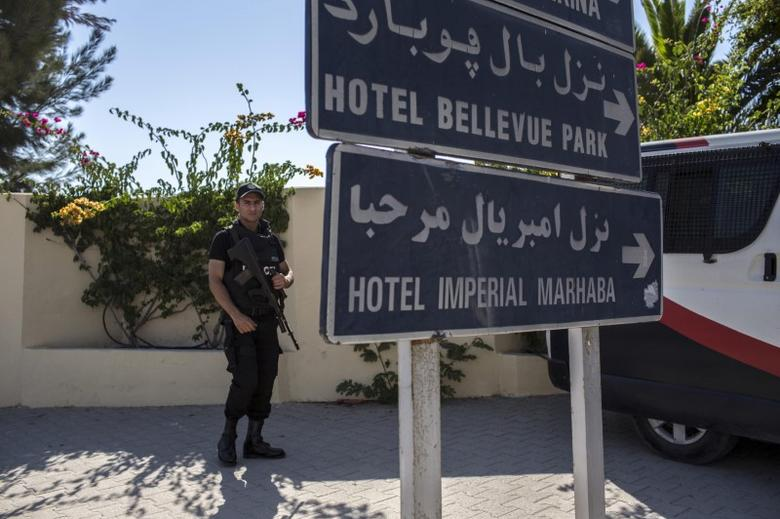File Photo - A police officer stands guard near the Imperial Marhaba resort, which was attacked by a gunman in Sousse, Tunisia, June 29, 2015.   REUTERS/Zohra Bensemra