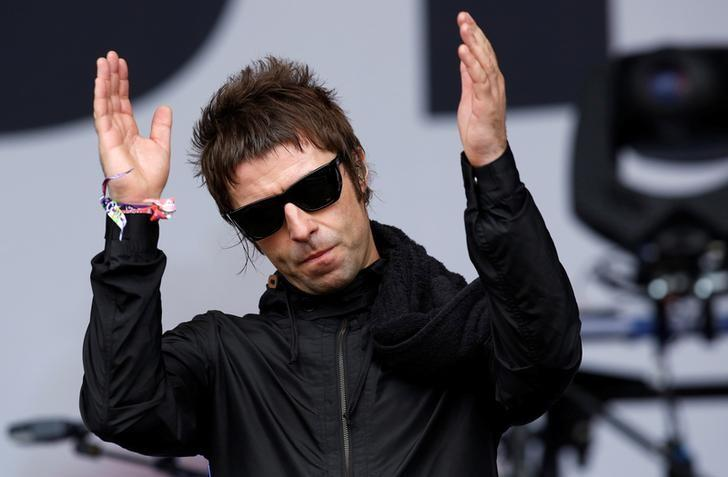 Liam Gallagher performs with his band Beady Eye during the Glastonbury music festival at Worthy Farm in Somerset, June 28, 2013. REUTERS/Olivia Harris/File Photo