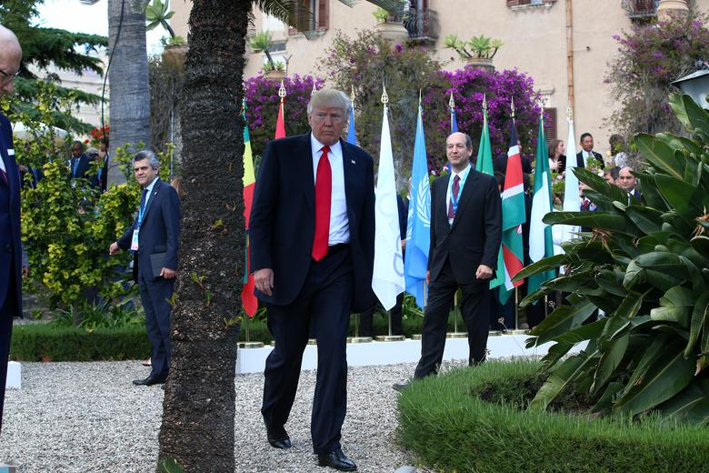 U.S. President Donald Trump leaves after a family photo at the G7 Summit expanded session in Taormina, Sicily, Italy, May 27, 2017. REUTERS/Alessandro Bianchi