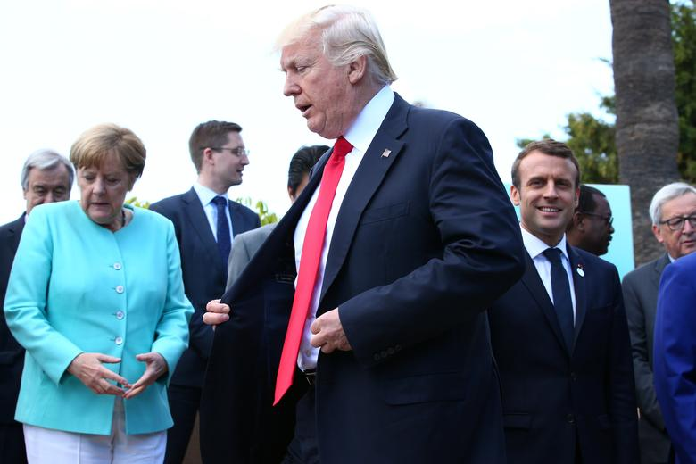 German Chancellor Angela Merkel, U.S. President Donald Trump and French President Emmanuel Macron during a family photo at the G7 Summit expanded session in Taormina, Sicily, Italy, May 27, 2017. REUTERS/Alessandro Bianchi