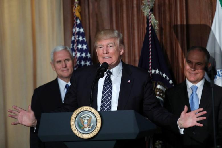 FILE PICTURE: U.S. President Donald Trump speaks between Vice President Mike Pence (L) and EPA Administrator Scott Pruitt prior to signing an executive order on ''Energy Independence,'' eliminating Obama-era climate change regulations, during an event at the Environmental Protection Agency (EPA) headquarters in Washington, U.S., March 28, 2017. REUTERS/Carlos Barria