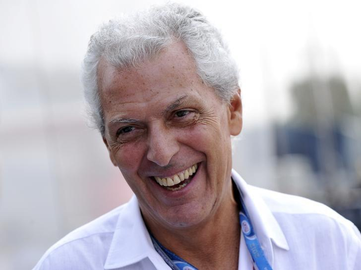 Pirelli president Marco Tronchetti Provera smiles in the paddock after the third practice session of the Italian F1 Grand Prix at the Monza circuit September 8, 2012.  REUTERS/Giorgio Perottino/files