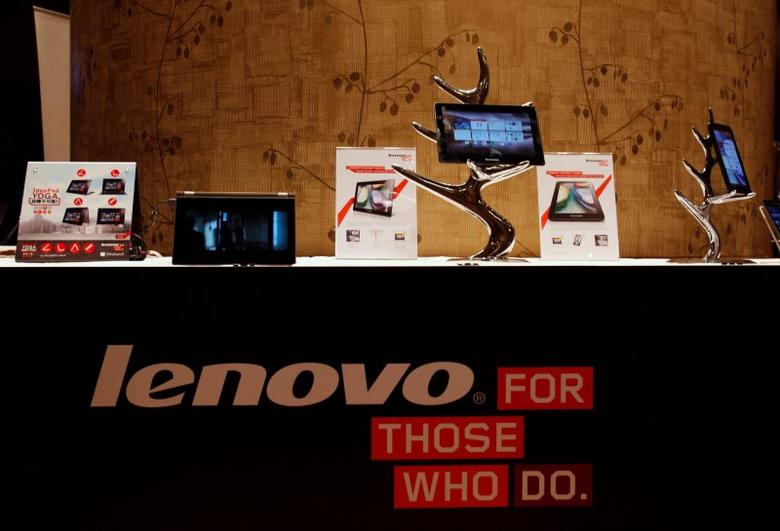 FILE PHOTO: Lenovo tablets and mobile phones are displayed during a news conference on the company's annual results in Hong Kong May 23, 2013.  REUTERS/Bobby Yip/File Photo