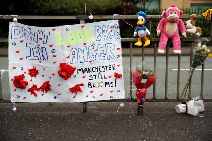 A banner, soft toys and flowers are displayed in Manchester, Britain, May 27, 2017. REUTERS/Phil Noble