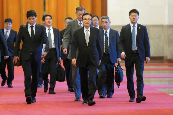 Japanese national security council chief Shotaro Yachi (front-C) arrives ahead of a meeting at the Great Hall of the People in Beijing, China, August 25, 2016. REUTERS/Wu Hong/Pool/Files