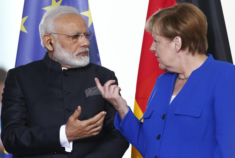German Chancellor Angela Merkel and Indian Prime Minister Narendra Modi talk before a signing ceremony at the 4th round of German-Indian government consultation at the Chancellery in Berlin, Germany, May 30, 2017. REUTERS/Hannibal Hanschke