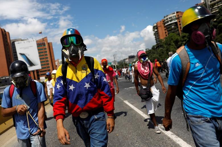 A demonstrator wearing a jacket with the colors of the Venezuelan national flag takes part in a protest against Venezuelan President Nicolas Maduro's government in Caracas, Venezuela May 29, 2017. REUTERS/Carlos Garcia Rawlins