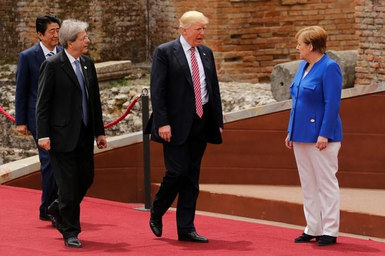 From R-L, German Chancellor Angela Merkel, U.S. President Donald Trump, Italian Prime Minister Paolo Gentiloni and Japanese Prime Minister Shinzo Abe arrive for a family photo at the start of G7 Summit at Greek Theatre in Taormina, Sicily, Italy, May 26, 2017. REUTERS/Jonathan Ernst